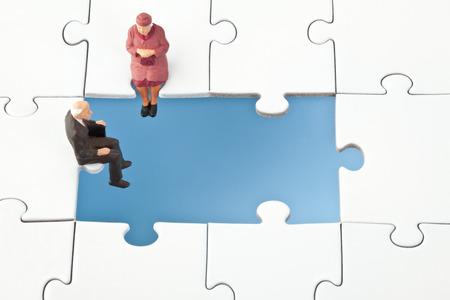 insecurity: Figurine sitting on jigsaw piece