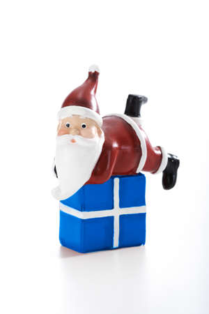 pere noel: Father Christmas lying on present isolated on white