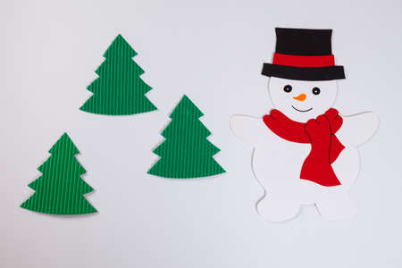 tinkering: Snowman and fir trees, white background