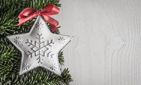 evergreens: Christmas decoration, evergreens, white wood, Stock Photo