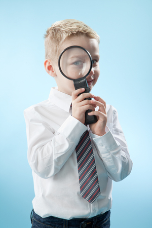 imitating: boy watching through magnifying glass