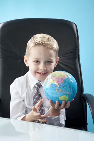 Prodigy: boy looking at globe