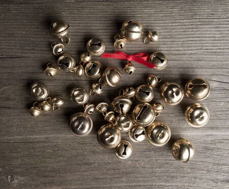 christmastime: Bells and bow on wood Stock Photo