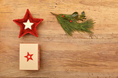 fir twig: Christmas present, fir twig and red bowl on wood