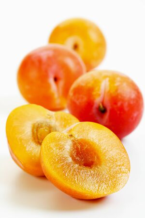 no food: Halved yellow plums