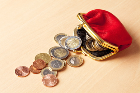 coin purses: Red purse filled with euro coins Stock Photo
