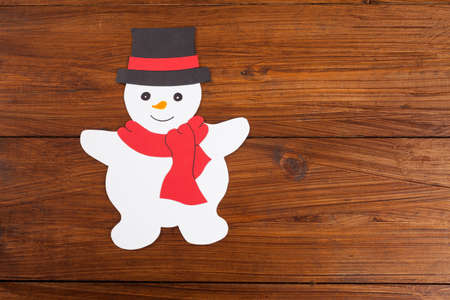 snowman wood: Snowman on wood, copy space