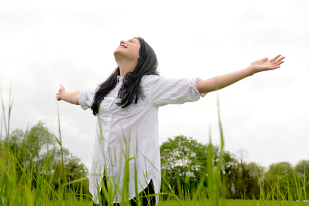 zest for life: Young happy woman on meadow Stock Photo