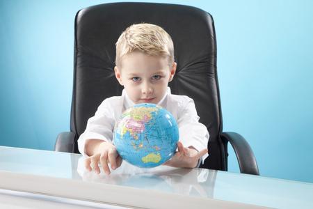 imitating: boy looking at globe