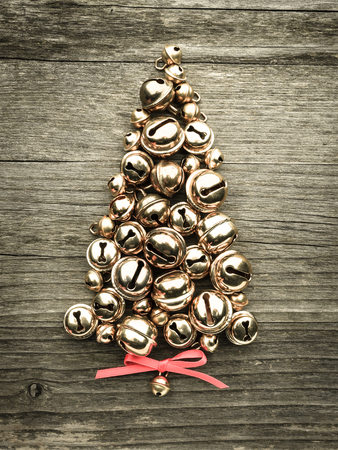 Bells, christmas tree on wood