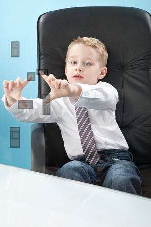 prodigy: boy touching transparent wipe board Zdjęcie Seryjne