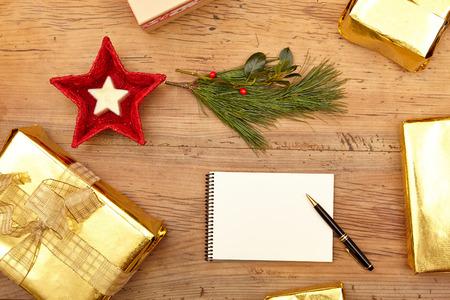 fir twig: Christmas presents, notepad and fir twig on wood