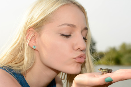 sexy young woman: Blonde woman kissing frog