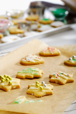 hundreds: Chrismas cookies decorated with hundreds and thousands Stock Photo