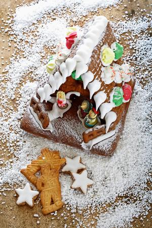 christmas house: Gingerbread house and Christmas cookies Stock Photo