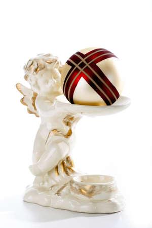 Angel figurine holding Christmas bauble