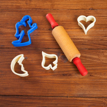 wood cutter: Biscuit cutter for christmas cookies, rolling pin on wood