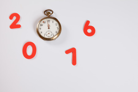 12 oclock: Year 2016, pocket watch, 12 oclock, white background, copy space