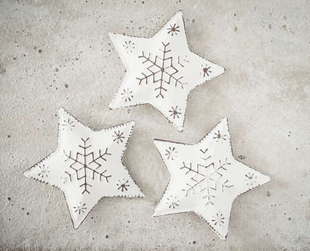 christmastime: Christmas decoration, stars of metal on concrete
