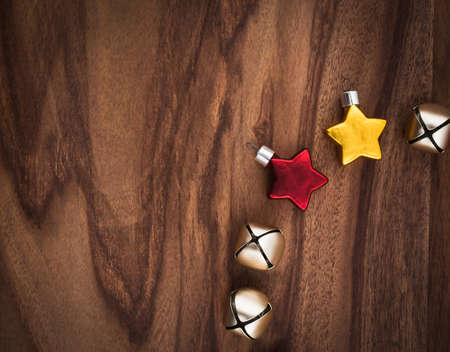christmastime: Christmas decoration, stars and bells on wood