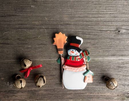 snowman wood: Christmas decoration of metal, snowman and bells on wood