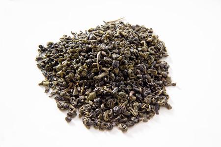gunpowder: Green tea, gunpowder tea, white background Stock Photo