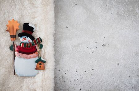 christmastime: Christmas decoration, angel on plush, concrete, copy space Stock Photo