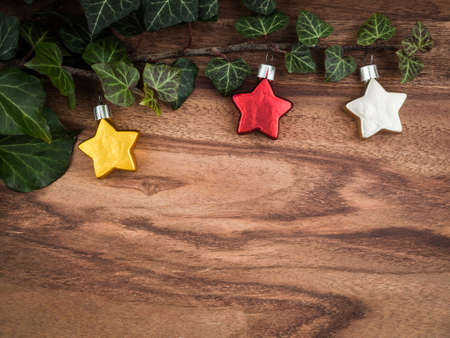 christmas ivy: Christmas, ivy, christmas decorations, stars on wood, copy space Stock Photo