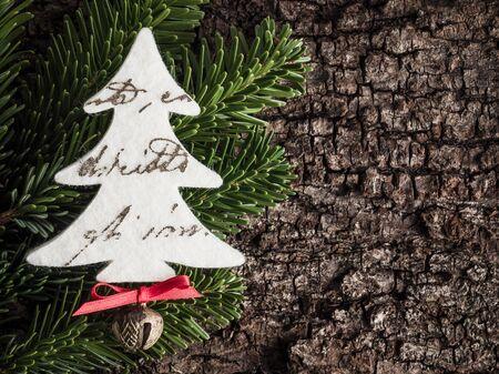 evergreens: Christmas decoration on bark, evergreens, christmas tree of felt