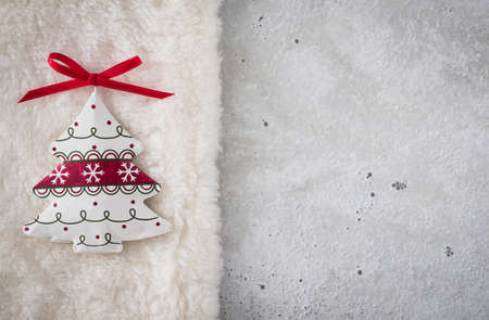 christmas time: Christmas decoration, christmas tree on plush, concrete