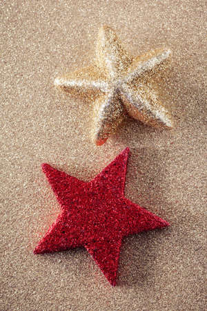 still lifes: Red and golden star on golden shiny background