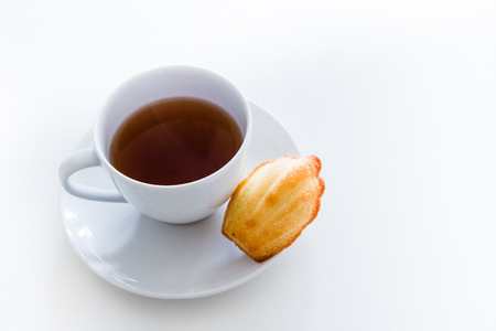 afters: Home made Madeleine cookie, tea cup Stock Photo