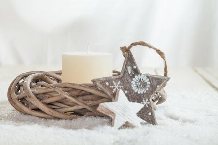 decorations wreaths: Christmas decoration, white candle, wreath, stars, copy space Stock Photo