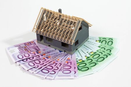 euro notes: Model house on fanned euro notes