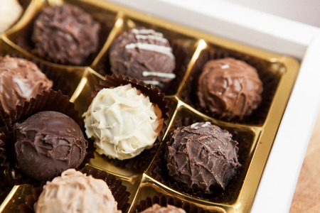 chocolate truffles: Close-up of a box of chocolate truffles Stock Photo