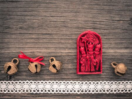 the magi: Christmas decoration of wax, the three Magi, bells, lace on wood Stock Photo