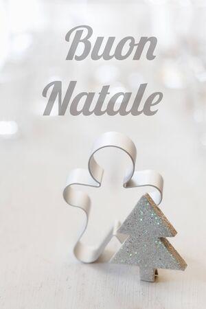buon: Christmas still life with cutter, Italian wishes, Buon natale Stock Photo