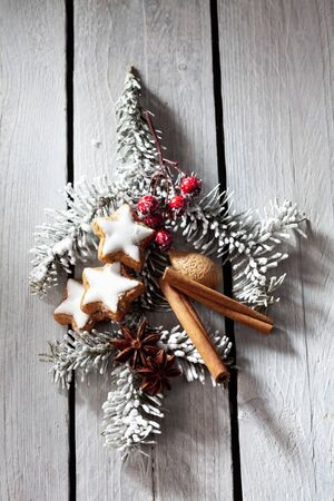 fir twig: Fir twig with cinnamon stars rose hips cinnamon sticks almond Stock Photo