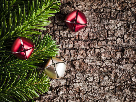 evergreens: Christmas decoration on bark, evergreens, bells Stock Photo
