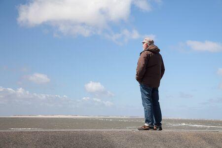 dyke: Germany, Wangerooge, North Sea, one man on dyke