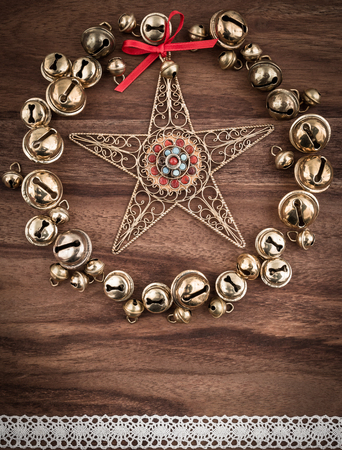 christmastime: Christmas, bells on wood, christmas decoration, star Stock Photo
