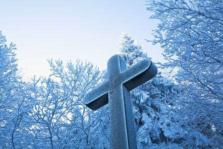 cross: Forest, frost-covered weather cross in winter Stock Photo