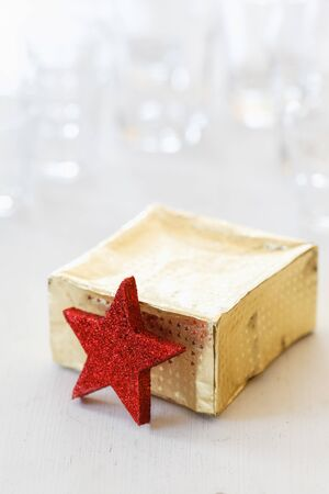 christmastime: Golden present and red star