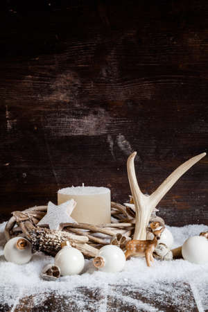 antler: Christmas decoration, wreath with white candle, baubles, antler