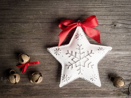 christmastime: Christmas decoration, star and bells on wood Stock Photo