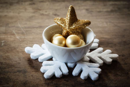 christmastime: Christmas decorations in bowl Stock Photo