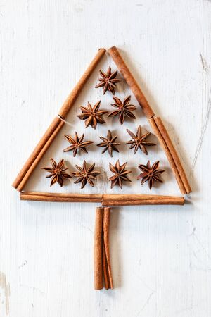 craft material tinker: Christmas tree of cinnamon sticks and star anise on white wood