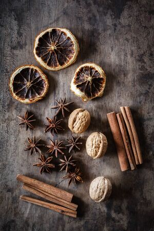 christmas scent: Still life with cinnamon sticks, dried oranges, star anis and walnuts