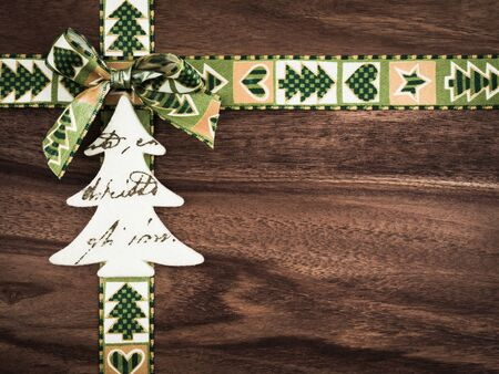 christmastime: Christmas, gift ribbon on wood, christmas decoration, tree of felt
