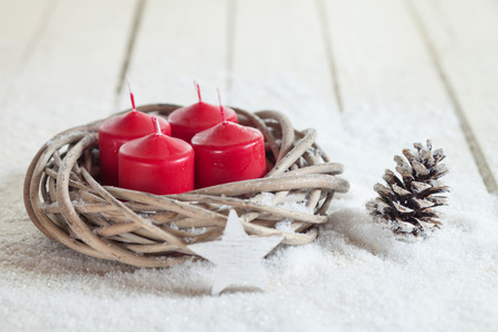 white candle: Wreath, red candles, wooden star, fir cone, copy space